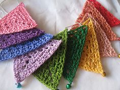 Granny triangles for bunting, pattern by Saritha at Rainbow Bunting Crochet Triangle, Crochet Squares, Crochet Motif, Crochet Stitches, Crochet Patterns, Granny Squares, Triangle Pattern, Crochet Home, Crochet Gifts