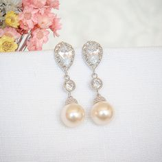 Elegant bridal earrings feature a classic teardrop shaped setting on the top, embedded with luxurious cubic zirconia. Embellished with a sparkly