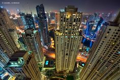Vertigorama - Well, my first shot with my newly acquired Nikon D800 & Nikkor 14-24mm f/2.8! Unfortunately it is not a blue hour shot, that day was quite hazy and humid, hence this purple haze... I might have to wait a long time before I get a clear weather here in Dubai, so I decided nevertheless to give the D800 a try.  Of course the 1024px resizing does not do any justice to this 36 Mpix camera. On my Flickr page I have posted a 100% crop view which really shows the amazing spatial…