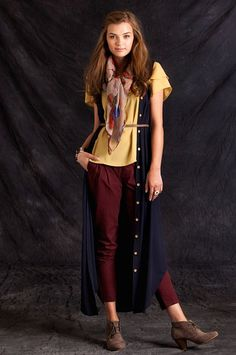 not sure about the whole thing, but I love that long cardi vest with the belt and pants