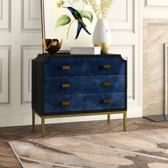 Hello, gorgeous is what everyone will be saying to the chest with its amped-up personality resulting from the dark sapphire finish enlivening the sycamore veneers on its door fronts! The wood grains bring the cabinet a hint of distressing that is juxtaposed against the sleek lines of the base in an antique brass finish and the glossy caviar black finish on the cabinet's exterior. The door pulls echo the lines in the wood grain, a sleight of hand their designers are so adept at producing. Design Hardwood Furniture, Accent Furniture, Home Furniture, Furniture Design, Furniture Ideas, Furniture Makeover, Humphrey Bogart, Blue Chests, Japanese Interior
