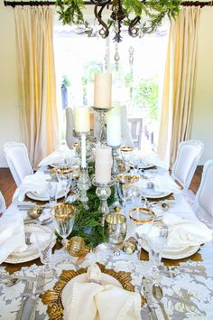 Christmas dining room. Elegant white and gold with evergreens pom-pom-at-home-linens