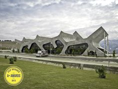 """Voted winner in the """"Best Bus Stops and Train Station"""" category - The Rest Stops in Gori, Georgia, by J. Mayer H. Architects: [Photo courtesy of Architizer] In the great tradition of brutalist transport hubs like Preston's threatened bus station; Unique Buildings, Amazing Buildings, Architecture Unique, Interior Architecture, Dubai Architecture, Concrete Architecture, Minimalist Architecture, Modernisme, Rest Area"""