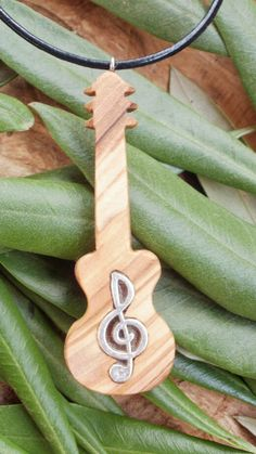 Hand carved Greek Olive Wood musical pendant by ellenisworkshop, $34.00
