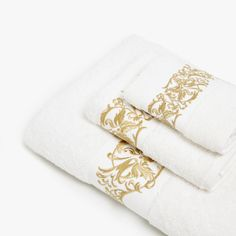 Towels with embroidered border