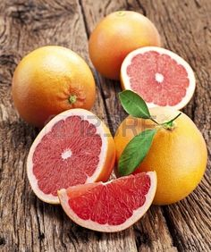 http://www.123rf.com/photo_16873169_grapefruit-with-slices-on-a-wooden-table.html