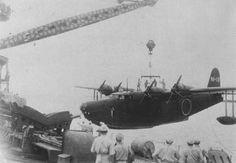 H8K1 N1-13 of the 802nd Kōkūtai and seaplane tender Akitsushima, Shortland Island in 1942.