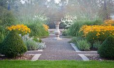 """ahhhhhh. formal lines and repetition with """"easy"""" perennials. I like the height and spread of the grasses."""