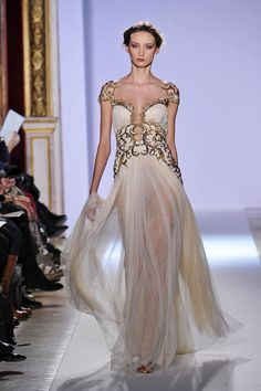 Zuhair Murad is the best when it comes to playing with sheer fabrics and trick fashion. Obsessed with all of his dresses.