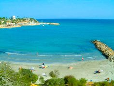 Cabo Roig, Spain. The Campoamor beach supplies an idyllic coastal landscape along the Costa Blanca. Crystal clear Mediterranean waters makes this one of the largest tourist attractions in Cabo Roig.