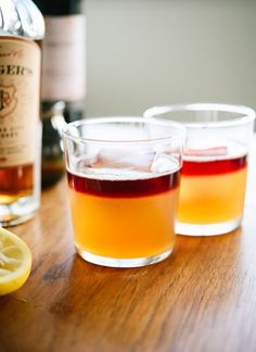 Make your own naturally sweetened New York sour cocktails at home! They're essentially whiskey sours, with a red wine float on top. Beautiful and delicious! cookieandkate.com