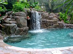 The natural swimming pool design with the waterfall in it will make the pool become awesome