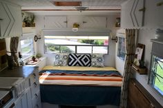 """We FINALLY made it. The big """"after"""" reveal of our brand new Elsie. When we  first started Camper DIY, I thought we would have reached this point months  earlier. But once we started cataloging all the work we did, it slowly grew  and grew. But we're happy to finally share in great detail what Elsie looks  like post-remodel."""