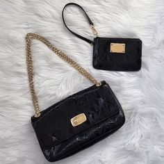 Michael Kors Black patent purse & clutch Preloved in excellent condition. Light scratches on label face. Barely noticeable (last picture) selling as a set only. Clean inside and out, non smoking home, beautiful set! Gold hardware. Plenty of compartments and credit card slots inside the purse and clutch.    Reasonable offers  ❌NO Trades❗️  Non smoking home  Same/next day  MICHAEL Michael Kors Bags