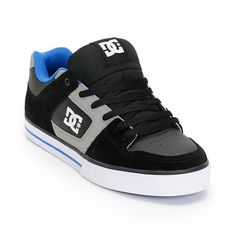 The DC Pure skate shoe for guys in the black, grey, and blue colorway has it all for your skate or casual needs. The DC Pure skate shoes feature a grippy wrap cup sole that has the look and durability of a vulcanized shoe, but is much lighter. This classic DC skate shoe also features a tough action suede and leather upper, a padded footbed for impact support and wear-all-day comfort, a lightly padded tongue and collar for foot protection, and extra stitching in the skate sensitive areas for…