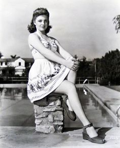 I love Joan Leslie and I love her playsuit! So cute :) Great shoes!!!