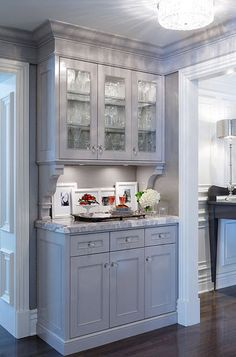 kitchens - gray glass-front cabinets corbels white carrara marble countertops butler& pantry Gorgeous gray butler& pantry design with gray Kitchen Redo, New Kitchen, Kitchen Cabinets, Kitchen Pantry, Gray Cabinets, Wall Cabinets, China Cabinets, Kitchen Ideas, Kitchen Corner