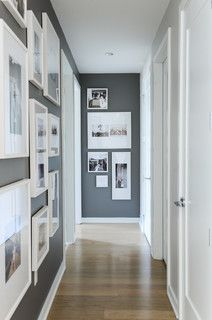 Love the floor to ceiling wall hangings in a narrow hallway. FALSE CREEK CONDO - contemporary - hall - other metro - by After Design