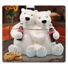 Coca-Cola Hugging Bears Cookie Jar.  Have a cookie with your Coke! This Coca-Cola Hugging Bears Cookie Jar looks like the polar bear mascots of Coca-Cola, hugging and enjoying the iconic soft beverage. Cookie jar is ceramic and stands 10 1/4-inches tall.