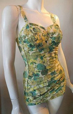 Gorgeous ruched 50s pin up swimsuit with citrus hued leaf print