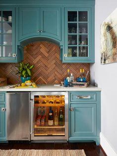 Love the bold kitchen cabinet paint color and backsplash!