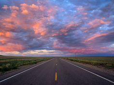 Road to nowhere, sunset like no other.  purple sky.