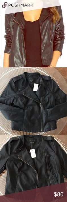 NWT Sanctuary Vegan Leather jacket Please note, the stock photo shows silver button/tab details - the jacket for sale has black buttons/tabs) I have provided the detailed photo of the black buttons; the first photo is for showcase.   .   **Asymmetrical zip front closure **Front pockets **Vegan leather,not PVC (good for the environment and our furry friends)  **Snap shoulder epaulets **Classic fit PRODUCT DETAILS: Shell: 100% polyurethane, Lining: 100% Cotton. Can be washed, but gentle cycle…