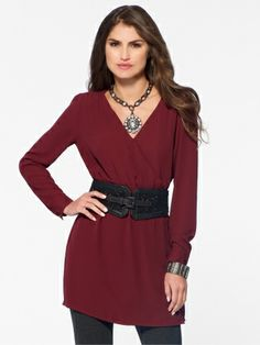 It's a cinch in this wine-hued tunic: a  v-neck flatters while an elastic waist adds comfort. But that open back is all allure. Long sleevesTrapunto stitching on shouldersOpen backButtoned cuffsElastic waistShown with belt - sold separately 100% polyesterImportHand wash