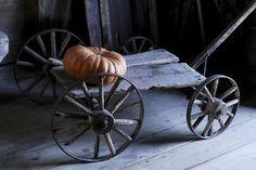 Cinderella pumpkin on antique wagon, King's Landing Historical Settlement. Primitive Autumn, Country Primitive, Primitive Homes, Primitive Antiques, Primitive Decor, Lonely Planet, Old Wagons, King's Landing, Primitive Furniture
