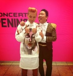"""G-Dragon snaps a risqué picture with Psy after the epic """"HAPPENING"""" concert"""