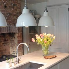 Love love love these industrial light fittings in this modern country kitchen. Why not head on over to join our FREE interior design resource library at www.FlorenceAndFreya.com?