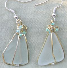 Gorgeous Sea Glass earrings gold and silver wire wrapped with beautiful beading. $20 Check out my other creations at www.miselaynesjewels.weebly.com.
