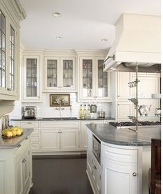 kitchens with dark wood floors | ... space, love the leaded glass, the classic subway and dark wood floors