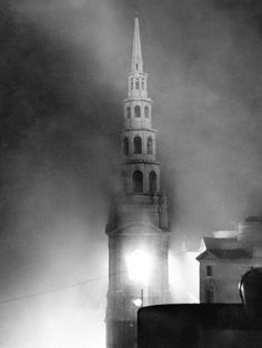 This is how St. Bride's Church in London appeared during the fire-blitz, Dec. 29, 1941. When air raiders showered incendiary bombs on the British capital. Flames lick around the base of the church's wedding cake spire after the roof of the church (at left) had collapsed.