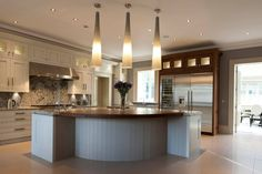 We specialise in manufacturing bespoke solid hardwood worktops. Made from wide planks or single staves of Iroko, Maple, Oak, Walnut, Ash & Cherry. Wine Fridge, Wide Plank, Work Tops, Walnut Worktops, Property For Sale, Hardwood, Island Design, Kitchen Island, Kitchens