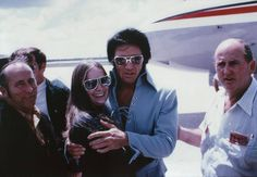 with a fan at the airport on July 9, 1970