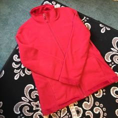 Red Zip Up It's a very soft, red zip up - inside and out. The interior is a silky, fur-like material. It is in like new condition, but somehow the tag managed to fall off during its first, and only, wash. I would definitely say it's a medium fit. Jackets & Coats