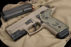 Sig Sauer P229 Scorpion. I would love to have one of these!!!