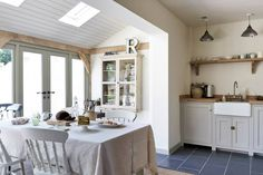 The Pembridge Shaker Kitchen by deVOL is painted in one of our most popular paint colours 'Mushroom'. Styling in this Border Oak property is by Merry Albright