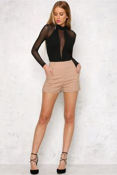 The Havoc Bodysuit has sexy mesh panels through the v-neck front and across the shoulders. With a semi sheer, full length sleeve and a solid body. There is a high neckline, an invisible back zipper and button down bottom for ease of wear. Style it with a high waisted leather skirt! Bodysuit. Not lined. Cold hand wash only. Model is standard XS and is wearing XS. True to size. Stretchy fabric. Polyester. Please note that all bodysuits are FINAL SALE. Due to hygiene reasons, they cannot be…