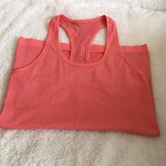 Lululemon Tank Lululemon Racerback Tank has no size tag on but is a 6 and in excellent condition. lululemon athletica Tops Tank Tops
