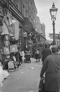 """Lambeth Walk October 1932 The building at the very back of the photo is """"The Feather's Public House"""""""
