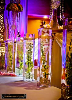 aisle vases, wedding decor - i just thought this was cool. But horrible if someone bumped into one and the water went all over the place.lol