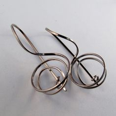 NIOBIUM SPIRAL EARRINGS wire coil small earrings. simple natural grey. modern minimal nickel free. locking hook corkscrew earrings No.00E242. $19.95, via Etsy. Gotta go there.