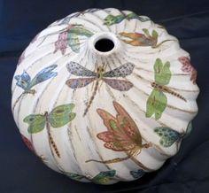 Dragonflies onto a spiral ceramic vase