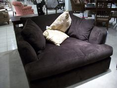 Big comfy oversized armchair where you can snuggle up with a good book, blanket and pillows!