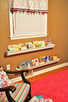 Rain Gutter Bookshelves... Love this idea. For behind the door. Cut several the same length and place in rows