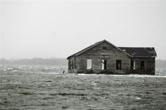 An abandoned home is inundated with water at Shinnecock Bay in Southampton, New York