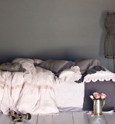 Celeste Duvet Cover in Petal, Adele Coverlet in Pebble, Linen Whisper Pillowcase in Graphite, Linen with Crochet Lace Sham in Petal, Linen with Crochet Lace Kidney Pillow in Graphite, Linen Whisper Kidney Pillow in Petal, Celeste Neckroll in Graphite, Linen Sheets in Graphite
