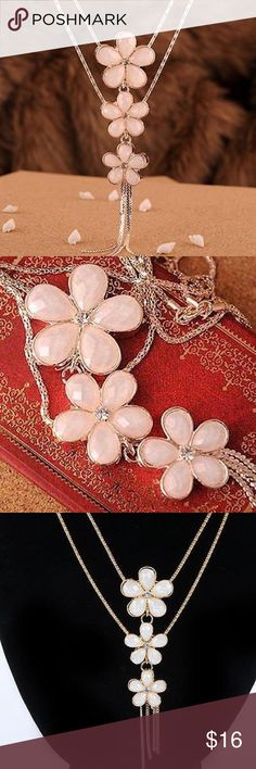 🌺Statement Bib Long Flower & Crystal Necklace Elegant and charming with crystals reflecting off of each lightly toned pink petals. Approximately 22.8 inches long. Trimmed in gold with a golden tassel at the bottom. Jewelry Necklaces